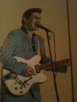 A portrait of Chris Isaak in our room